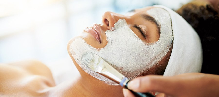Woman getting facial treatment - model stock photo